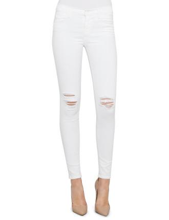Mid Rise Super Skinny In White W/ Torn Knee